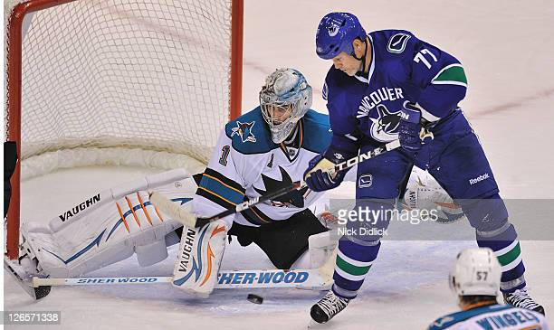 Owen Nolan of the Vancouver Canucks tries to deflect the puck past Goaltender Thomas Greiss of the San Jose Sharks during their game at Rogers Arena...