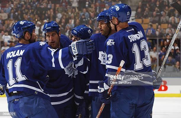 Owen Nolan#11 Ken Klee Carlo Colaiacovo Mikael Renberg and Mats Sundin all of the Toronto Maple Leafs celebrate a goal against the Ottawa Senators...