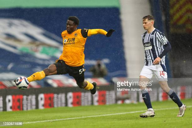 Owen Otasowie of Wolverhampton Wanderers and Conor Townsend of West Bromwich Albion during the Premier League match between West Bromwich Albion and...