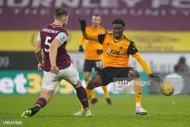 Owen Otasowie of Wolverhampton Wanderers attempts to block a shot from James Tarkowski of Burnley during the Premier League match between Burnley and...