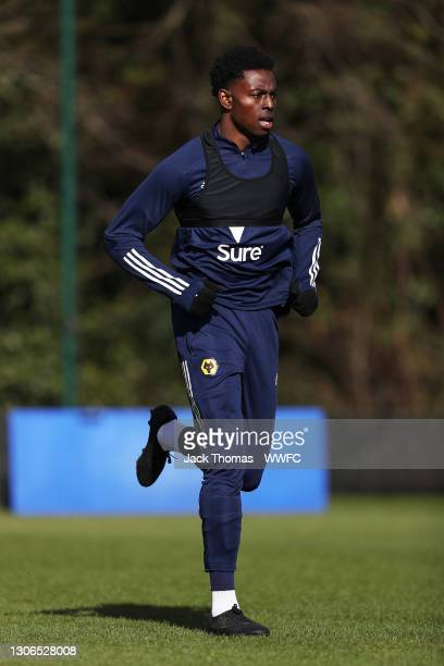 Owen Otasowie of Wolverhampton Wanderers runs during a Wolverhampton Wanderers Training Session at Sir Jack Hayward Training Ground on March 11, 2021...