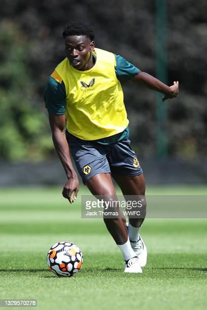 Owen Otasowie of Wolverhampton Wanderers runs with the ball during a Wolverhampton Wanderers Pre-Season Training Session at Sir Jack Hayward Training...