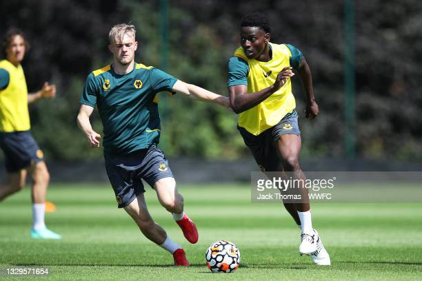 Owen Otasowie of Wolverhampton Wanderers runs with the ball under pressure from Taylor Perry of Wolverhampton Wanderers during a Wolverhampton...