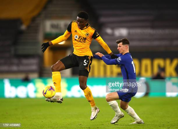 Owen Otasowie of Wolves is challenged by Mason Mount of Chelsea during the Premier League match between Wolverhampton Wanderers and Chelsea at...
