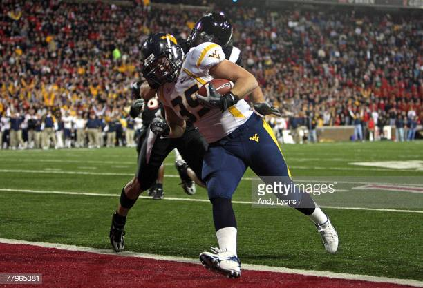 Owen Schmitt of the West Virginia Mountaineers runs for a touchdown during the Big East Conference game against the Cincinnati Bearcats at Nippert...
