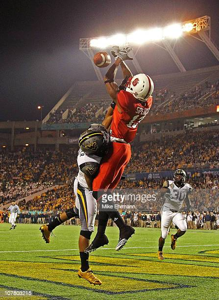 Owen Spencer of the North Carolina State Wolfpack misses a touchdown catch defended by Will Johnson of the West Virginia Mountineers during the...