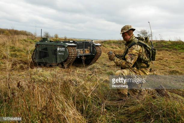 Owen Stringer a rifleman in the British Army operates a Tracked Hybrid Modular Infantry System THeMIS developed by Milrem Robotics and QinetiQ Group...