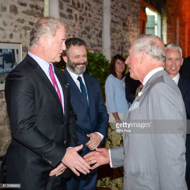 Owen Teale and Martin Sheen greet Prince Charles Prince of Wales at his Welsh home near Llandovery where he is hosting a music and drama evening also...