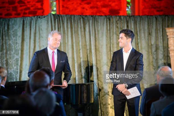 Owen Teale and Richard Henderson perform for Prince Charles Prince of Wales at his Welsh home near Llandovery where he is hosting a music and drama...