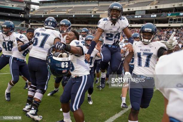 Owen Thomas MJ Dumas Amin Black Darius Pickett and Nowooola Awopetu of the Villanova Wildcats celebrate after the game against the Temple Owls at...