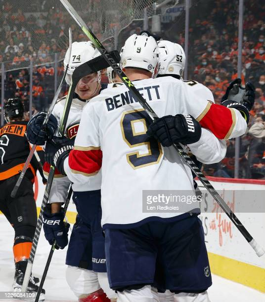 Owen Tippett of the Florida Panthers celebrates his second period goal against the Philadelphia Flyers with Sam Bennett and MacKenzie Weegar at the...