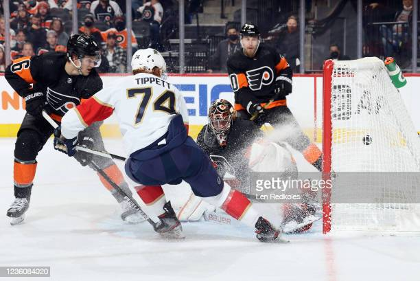 Owen Tippett of the Florida Panthers scores a second period goal against Carter Hart, Travis Sanheim, and Rasmus Ristolainen of the Philadelphia...