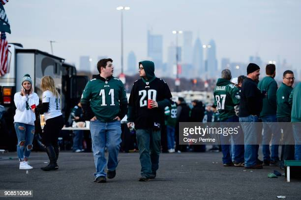 Owen Walters of Souderton Pennsylvania and Kevin Colden of Phoenixville Pennsylvania walk while tailgating at Lincoln Financial Field on January 21...