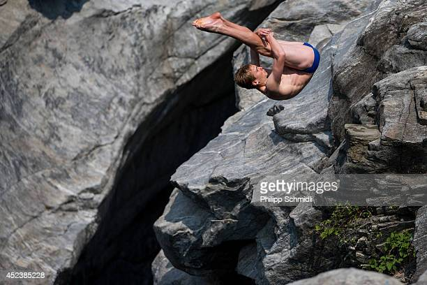 Owen Weymouth of UK dives from a 15 metre rock during the Cliff Diving European Championship on July 19 2014 in Ponte Brolla near Locarno Switzerland