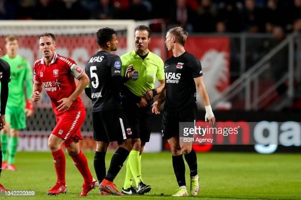Owen Wijndal of AZ and referee Danny Makkelie during the Dutch Eredivisie match between FC Twente and AZ at De Grolsch Veste on September 23, 2021 in...
