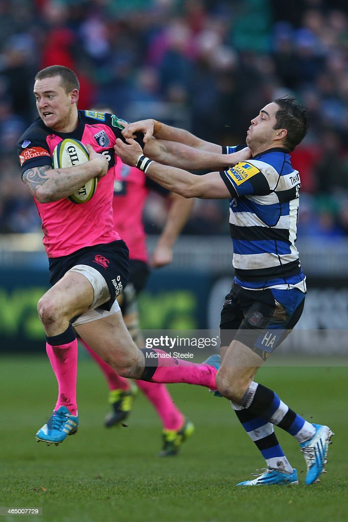 Owen Williams (L) of Cardiff Blues holds off Horacio Agulla (R) of Bath during the LV Cup match between Bath and Cardiff Blues at the Recreation Ground on January 25, 2014 in Bath, England.