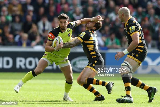 Owen Williams of Leicester holds off Danny Cipriani during the Aviva Premiership semi final match between Wasps and Leicester Tigers at The Ricoh...