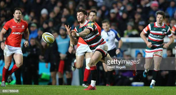 Owen Williams of Leicester passes the ball during the Aviva Premiership match between Leicester Tigers and Saracens at Welford Road on January 1 2017...