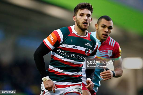 Owen Williams of Leicester Tigers and Joe Marchant of Harlequins chase the ball during the Aviva Premiership match between Leicester Tigers and...