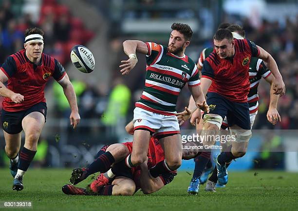 Owen Williams of Leicester Tigers breaks from Tyler Bleyendaal of Munster during the European Rugby Champions Cup match between Leicester Tigers and...