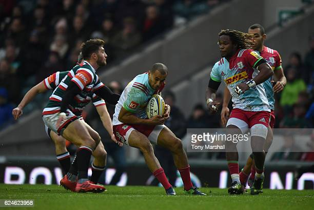 Owen Williams of Leicester Tigers tackles Aaron Morris of Harlequins during the Aviva Premiership match between Leicester Tigers and Harlequins at...