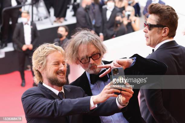 """Owen Wilson, Jarvis Cocker and Benicio Del Toro attend the """"The French Dispatch"""" screening during the 74th annual Cannes Film Festival on July 12,..."""