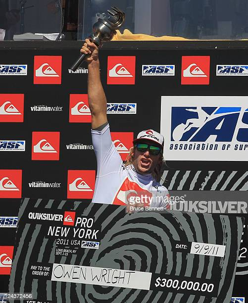 Owen Wright of Australia celebrates his victory at the Quiksilver Pro New York surfing tournament on September 9 2011 in Long Beach New York