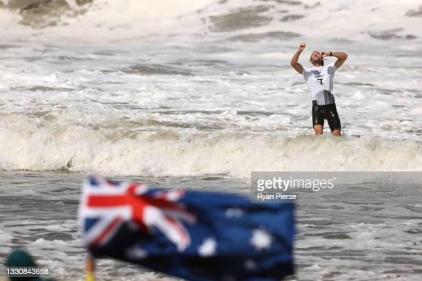 Owen Wright of Team Australia celebrates winning his men's Bronze Medal match against Gabriel Medina of Team Brazil on day four of the Tokyo 2020...