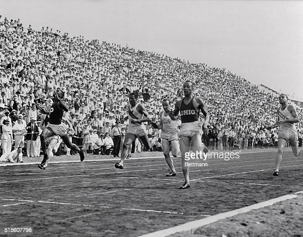 Owens wins 200-meter dash. Randall's Island, NY: Jesse Owens, Ohio State, coming home in front to win the 200-meter dash at the final Olympic Track...