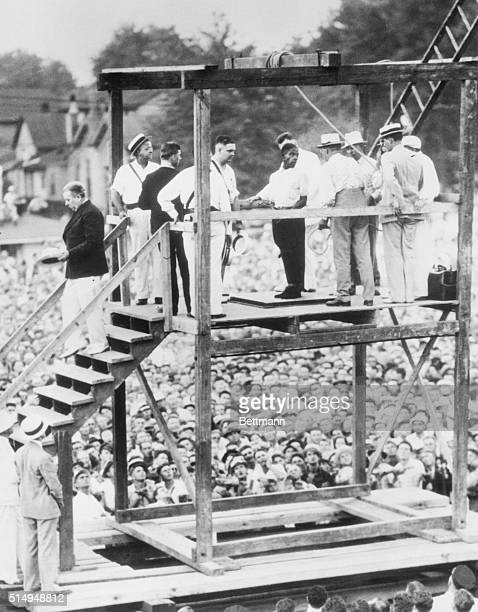 Rainey Bethea 22yearold Negro shown on the gallows talking to an officer just before he was hanged in the presence of a crowd estimated at 20000...