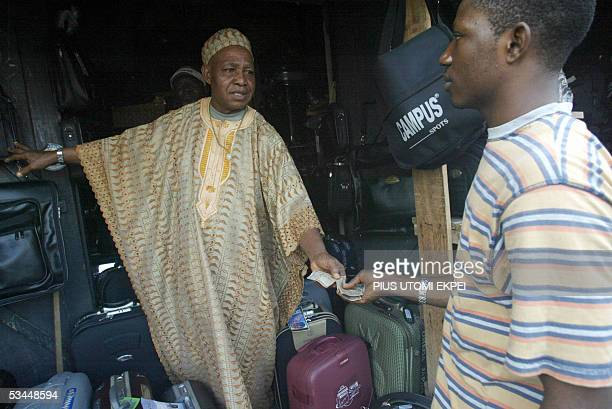 Businessman Steven Nweze trades his leather bags with Biafran currency at the Nworie lane market in Owerri in southeastern Nigeria Friday 19 August...
