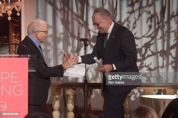 Owner Advance Publications Donald Newhouse presents an award from Sen Charles E Schumer on stage during The Association for Frontotemporal...