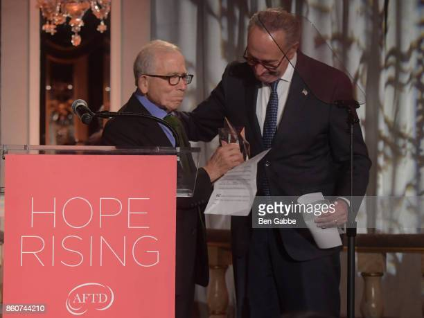 Owner Advance Publications Donald Newhouse presents an award to Sen Charles E Schumer on stage during The Association for Frontotemporal...