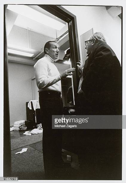 Owner Al Davis of the Oakland Raiders talks to sportswriter Leonard Koppett of the New York Times following the 1976 AFC Championship Game at...