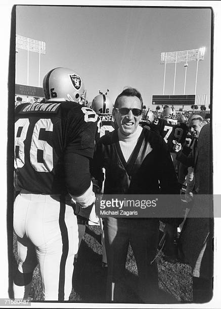 Owner Al Davis of the Oakland Raiders walks the sideline before the 1980 AFC Wild Card Playoff Game against the Houston Oilers at Oakland-Alameda...