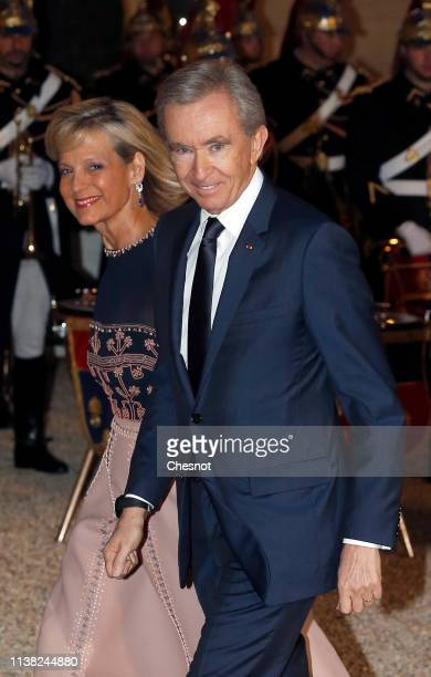 Owner and CEO of LVMH Luxury Group Bernard Arnault and his wife Helene Arnault arrive at the Elysee Presidential Palace for a state dinner with...