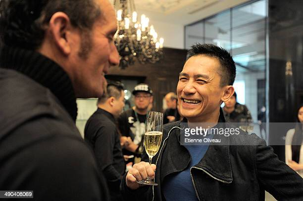 Owner and designer of Chrome Hearts Richard Stark and Hong Kong international actor Tony Leung laughing during the Chrome Hearts Beijing Store...