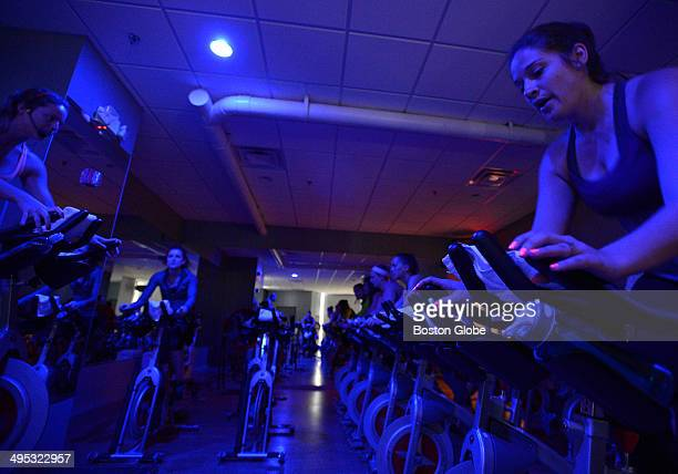 Owner and instructor Jessica Bashelor left teaches on May 14 2014 a lunchtime spin class at The Handle Bar indoor cycling spin studio in South Boston...