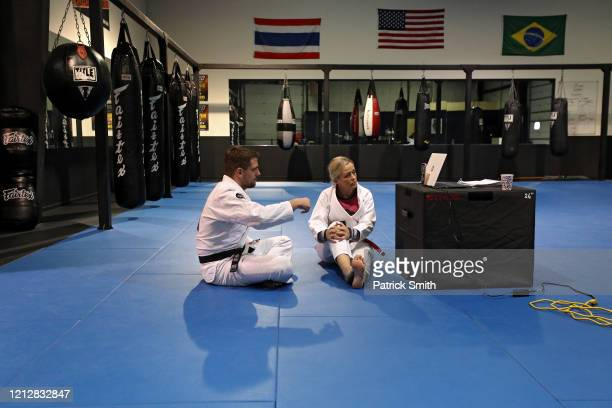 Owner and operators of Method MMA, Eddie Abney and his wife, Michelle Abney, interact with their customers as they broadcast Facebook live video...