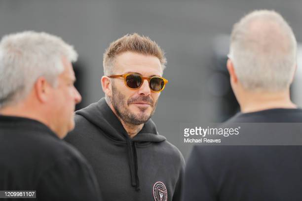 Owner and President of Soccer Operations David Beckham of Inter Miami CF talks with sporting director Paul McDonough and owner Jorge Mas ahead of...