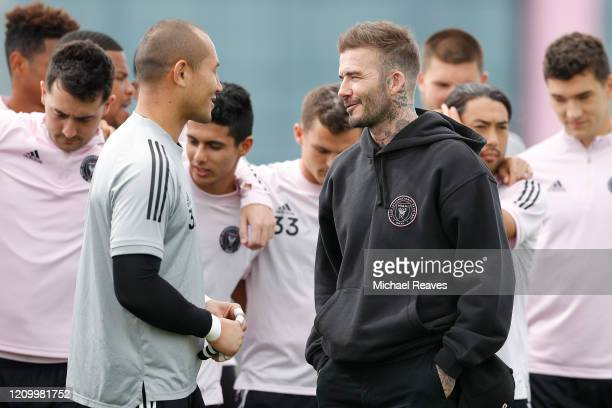 Owner and President of Soccer Operations David Beckham of Inter Miami CF talks to goalie Luis Robles ahead of Inter Miami CF's inaugural match on...