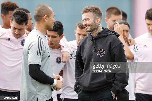 Owner and President of Soccer Operations David Beckham talks with goalie Luis Robles after he was named club captain during media availability at...