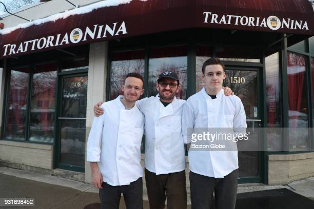 Owner Angelo Carbini center poses for a portrait with his sons Nico Carbini left and Stfano Carbini outside Trattoria Nina in Arlington MA on March 9...
