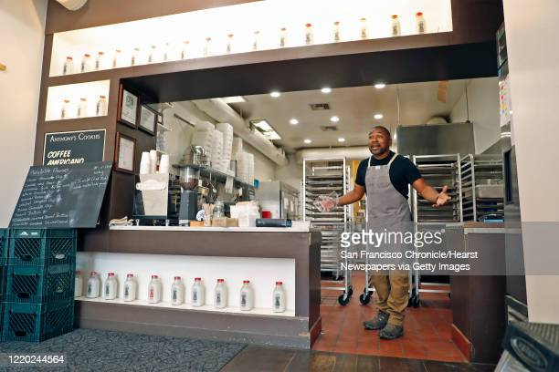 Owner Anthony Lucas interacts with a customer at Anthony's Cookies on Valencia Street in San Francisco Calif on Monday April 13 2020 Fear of...