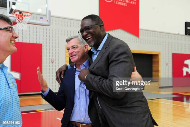 Owner Antony Ressler of the Atlanta Hawks hugs Dominique Wilkins after Lloyd Pierce's introductory press conference on May 14 2018 at the Emory...