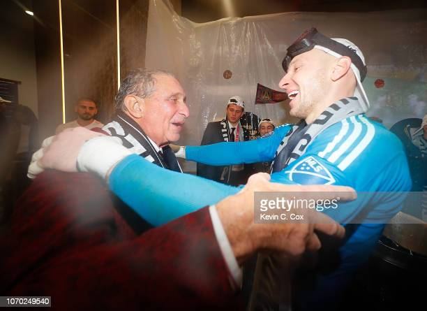 Owner Arthur Blank hugs goalkeeper Brad Guzan of Atlanta United as they celebrate their 20 win over the Portland Timbers during the 2018 MLS Cup...