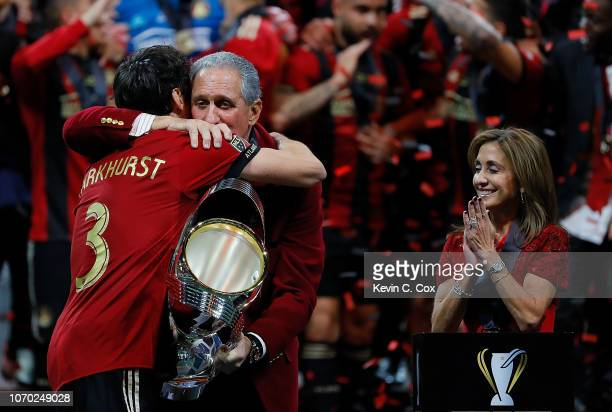 Owner Arthur Blank hugs Michael Parkhurst as he hands over the MLS Cup after their 20 win over the Portland Timbers during the 2018 MLS Cup between...