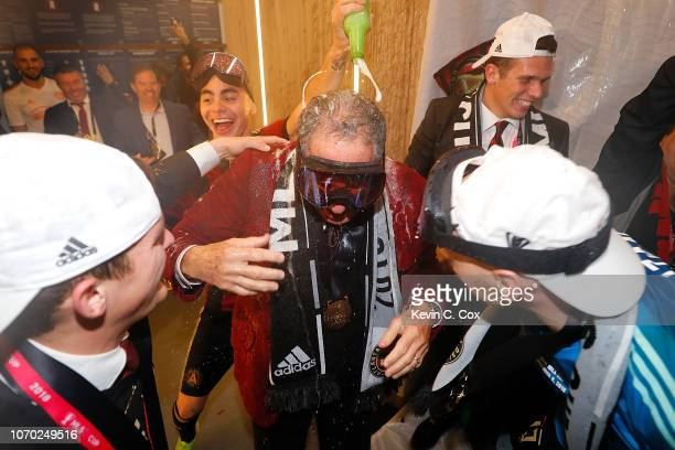 Owner Arthur Blank is doused by Miguel Almiron as they celebrate their 20 win over the Portland Timbers during the 2018 MLS Cup between Atlanta...