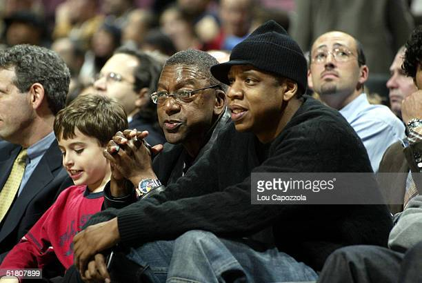 Owner Bob Johnson of the Charlotte Bobcats watches the game with part owner/entertainer JayZ of the New Jersey Nets on November 30 2004 at the...