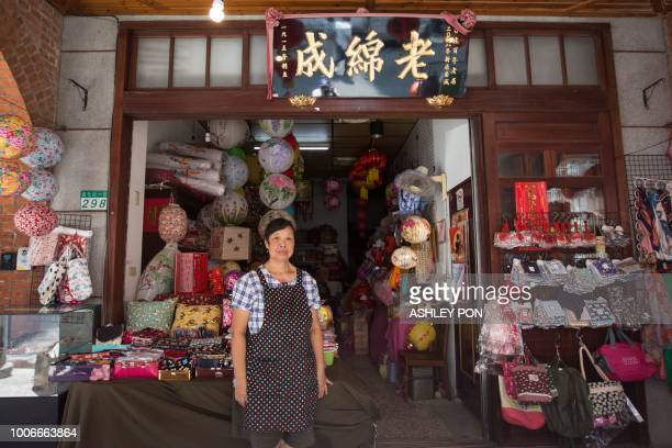 Owner Chang Mei Mei poses in front of the Lao Mian Cheng Lantern shop in Dadaocheng Taipei on July 28 2018 The shop was founded in 1915 The historic...